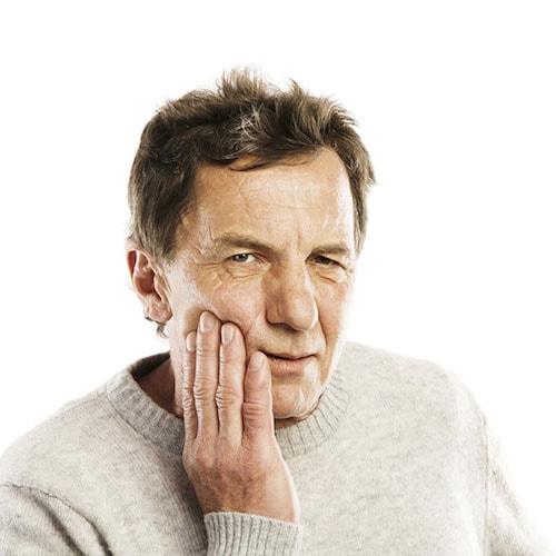 A senior men having a toothache