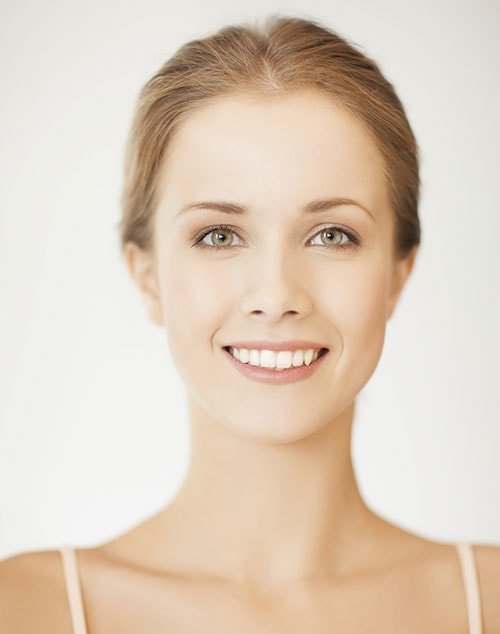 A woman smiling in a white background